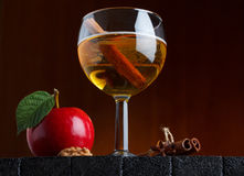 Cider glass still life. With apple and cinnamon stick on wooden table Royalty Free Stock Photo