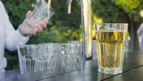 Cider in a glass on a wooden board.  stock video footage