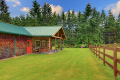 Cider house with covered deck and horse ranch Royalty Free Stock Photo