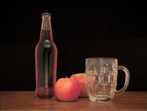 Cider. Still life of a bottle of cider with glass and apples Royalty Free Stock Photography