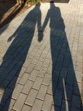 Cień pary mienia ręki, miłość Fotografia Royalty Free