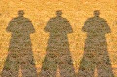 Cień Trzy fotografów mężczyzna na polu Obrazy Royalty Free