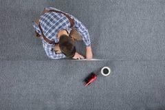 Cieśla Kłaść dywan obrazy royalty free