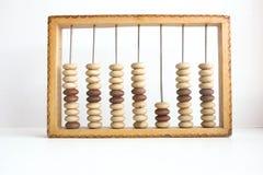 Cień gospodarki abakusa Drewniany kalkulator Fotografia Stock