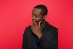 Ciekawić plotkuje Zainteresowany amerykanin afrykańskiego pochodzenia zdjęcie stock