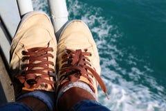 Cieki i buty na łodzi Obraz Royalty Free