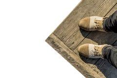 Cieki w butach na drewnianym tle fotografia royalty free