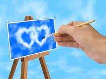 Ciel bleu et nuages en forme de coeur sur le support Photo libre de droits
