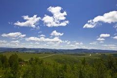 Ciel bleu et prairie Images libres de droits