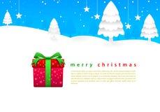 Ciel bleu lumineux de Joyeux Noël et aro blanc de neige Photographie stock libre de droits