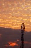 Ciel de lever de soleil avec la tour Photos stock