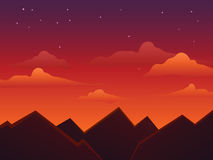 Cieli di crepuscolo sopra le montagne Immagine Stock