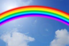 Cielo azul con el arco iris Foto de archivo