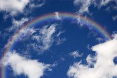 Cielo azul con el arco iris Imagen de archivo libre de regalías