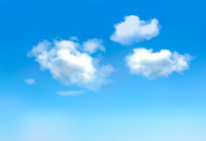 Cielo azul con las nubes. Imagenes de archivo