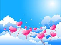 Cielo azul con los corazones rosados y amarillos Imagen de archivo libre de regalías