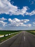 Cielo blu della strada Immagine Stock