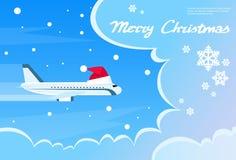 Cielo blu di Santa Red Christmas Hat Cloud dell'aeroplano Fotografia Stock