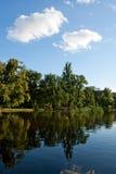Cielo blu e lago Fotografia Stock