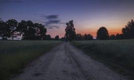 Cielo crepuscolare sopra la campagna scenica Fotografie Stock