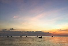 Cielo del barco, del mar y del suneset Imagen de archivo