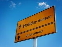 Cielo del fondo de la señal de tráfico de las vacaciones. Foto de archivo libre de regalías