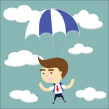 Cielo di caduta dell'uomo d'affari con il paracadute blu Immagine Stock Libera da Diritti