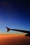 Cielo ed aeroplani di tramonto Immagini Stock