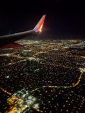 Cielo notturno della città da un aereo di sud-ovest Fotografia Stock