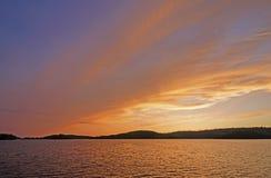 Cielos anaranjados en país de la canoa Imagen de archivo libre de regalías