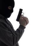 Ciemna sylwetka włamywacz lub terrorysta w masce z pistoletem odizolowywamy Obrazy Royalty Free