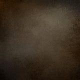 Ciemnego brązu tło z słoistą szorstką textured grunge granicą Fotografia Stock