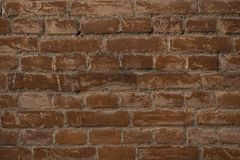 Ciemnego grunge tła brązu stara ściana z cegieł zdjęcia royalty free