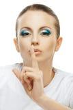 Ciemnowłosa kobieta podnoszący wskaźnik Obrazy Stock