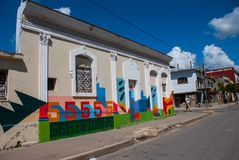 Cienfuegos, Cuba: Cuban street houses drawings with colorful graffiti.  stock photos