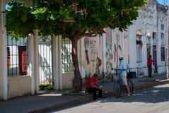Cienfuegos, Cuba: Cuban street houses drawings with colorful graffiti.  stock images