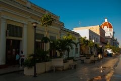 Cienfuegos, Cuba: The main street, and the dome of the building Municipal Palace, City Hall, Government Palace dome. stock photography