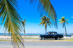 Cienguegos water front street. Black car, Cienguegos street, Cuba Stock Photos