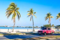 Cienguegos water front street. Pink car, Cienguegos street, Cuba Royalty Free Stock Photo