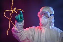Científico Touching Ebola Virus Imágenes de archivo libres de regalías