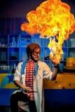 Cientista com braço ardente Fotos de Stock