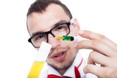 Cientista com seringa Foto de Stock Royalty Free