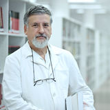 Cientista/doutor em uma biblioteca Foto de Stock