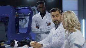 Cientistas que exploram tecnologias 3-D da impressão filme