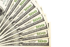 Cientos billetes de banco del dólar aislados en un blanco Imagen de archivo