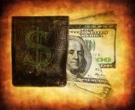 Cientos billetes de banco del dólar en el monedero Imagen de archivo
