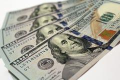 Cientos billetes de banco del dólar aislados Foto de archivo libre de regalías