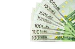 Cientos billetes de banco del euro en un fondo blanco fotos de archivo libres de regalías