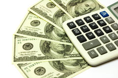 Cientos billetes de banco y calculadoras del dólar Fotos de archivo libres de regalías