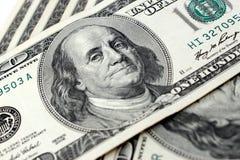 Cientos billetes de dólar Foto de archivo
